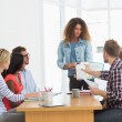 Woman presenting ideas to young designers — Stockfoto