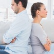 Annoyed couple sitting back to back on the couch — Stock Photo #42935235