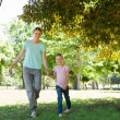 Happy mother and daughter walking at park — Stock Photo #42935369