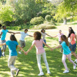 Friends walking in a circle at park — Stock Photo #42935489