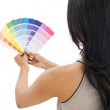 Rear view of a woman looking at paint samples — Stock Photo #42935543