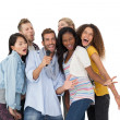 People singing into microphone — Stock Photo #42936577