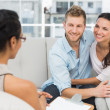 Smiling couple reconciling at therapy session — Stock Photo #42937009