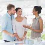 Interior designer speaking with happy clients — Stock Photo #42937291