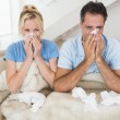 Couple suffering from cold in bed — Stock Photo #42937427