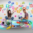Cheering girl and casual man using laptop with app icons — Stock Photo #42937827