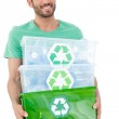 Man carrying recycle containers — Stock Photo #42937841