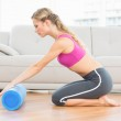 Blonde using foam roller — Stock Photo #42938319