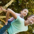 Happy mother carrying daughter at park — Stock Photo