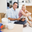 Couple using tablet in a new house — Stock Photo #42938721