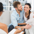 Happy couple reconciling at therapy session — Foto Stock