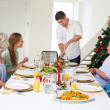 Father serving Christmas meal to family — Stock Photo #42939051