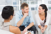 Unhappy couple at therapy session — Stock Photo