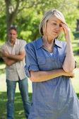 Sad couple in parkland — Stock Photo