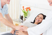 Pregnant woman with man and doctor — Stock Photo