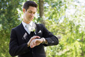 Groom checking time — Stock Photo