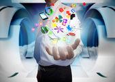 Businessman presenting app icons — Stock Photo