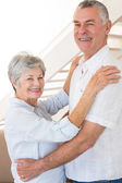 Affectionate senior couple dancing together — Stock Photo
