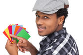 Man with colorful papers — Foto de Stock