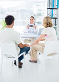 Expectant couple consulting gynaecologist — Stock Photo