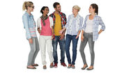 Full length of casually dressed young people — Stock Photo