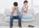 Couple on the couch after an argument — Stock Photo
