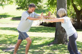 Couple working out in the park — Foto Stock