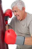Portrait of a determined senior boxer — Stok fotoğraf