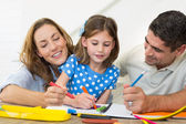 Family coloring together — Stock Photo