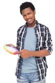 Portrait of a young man with paint samples — Stock Photo