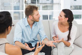 Couple arguing at therapy session — Stock Photo