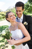 Bride looking at man in park — Stock Photo