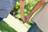 Romantic couple holding hands — Stock Photo