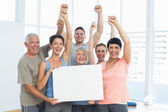 Happy fit people holding blank board — Stock Photo
