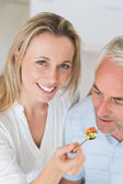Happy woman feeding her partner a spoon of vegetables — Foto de Stock