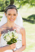 Bride holding flower — Stock Photo