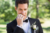 Groom biting nails in garden — Stok fotoğraf