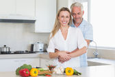 Affectionate couple preparing a healthy dinner together — Stock Photo