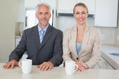 Happy business couple having coffee before work in morning — Stock Photo
