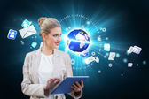 Businesswoman using tablet pc with earth and emails — Stockfoto