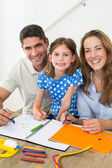 Daughter and parents coloring — Stock Photo