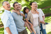 Cheerful extended family standing at park — Stock Photo