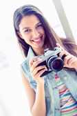 Woman holding her camera — Stock Photo