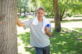 Man with bottle of water in park — Stock Photo