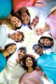 Friends forming huddle — Stock Photo
