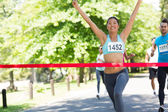 Female marathon winner — Stock Photo