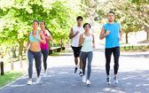 Marathon athletes running on street — Stock Photo
