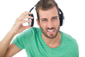 Irritated young man with headphones — Stock Photo