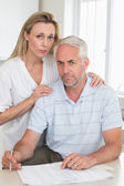 Worried couple working out their finances — Stock Photo