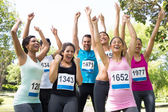 Friends cheering after winning a race — Stock Photo